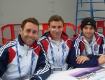 Jonty Clarke, Harry Martin and  Nick Catlin of Team GB sign autographs after the match.