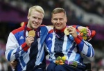Jonnie Peacock and David Weir celebrate with their gold medals. 
