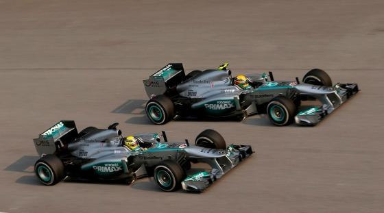 Lewis Hamilton and Nico Rosberg race at the 2014 Malaysian Grand Prix.